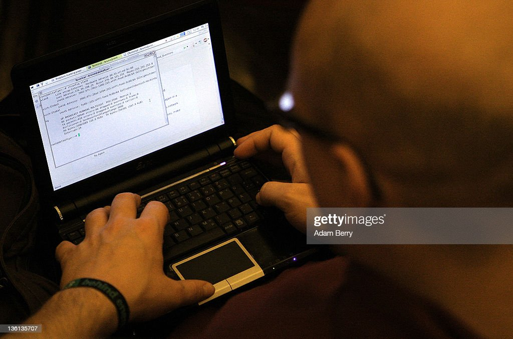 A participant looks at lines of code on a laptop on the first day of the 28th Chaos Communication Congress (28C3) - Behind Enemy Lines computer hacker conference on December 27, 2011 in Berlin, Germany. The Chaos Computer Club is Europe's biggest network of computer hackers and its annual congress draws up to 3,000 participants.