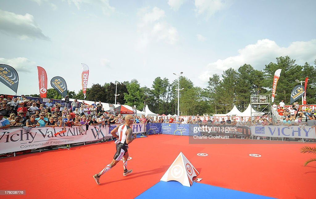A participant makes his way to the finish line during the Challenge Triathlon Vichy on September 01, 2013 in Vichy, France.
