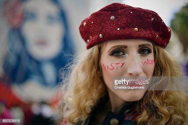 A participant marches during the Women's March on January 21 2017 in Los Angeles California Tens of thousands of people took to the streets of...