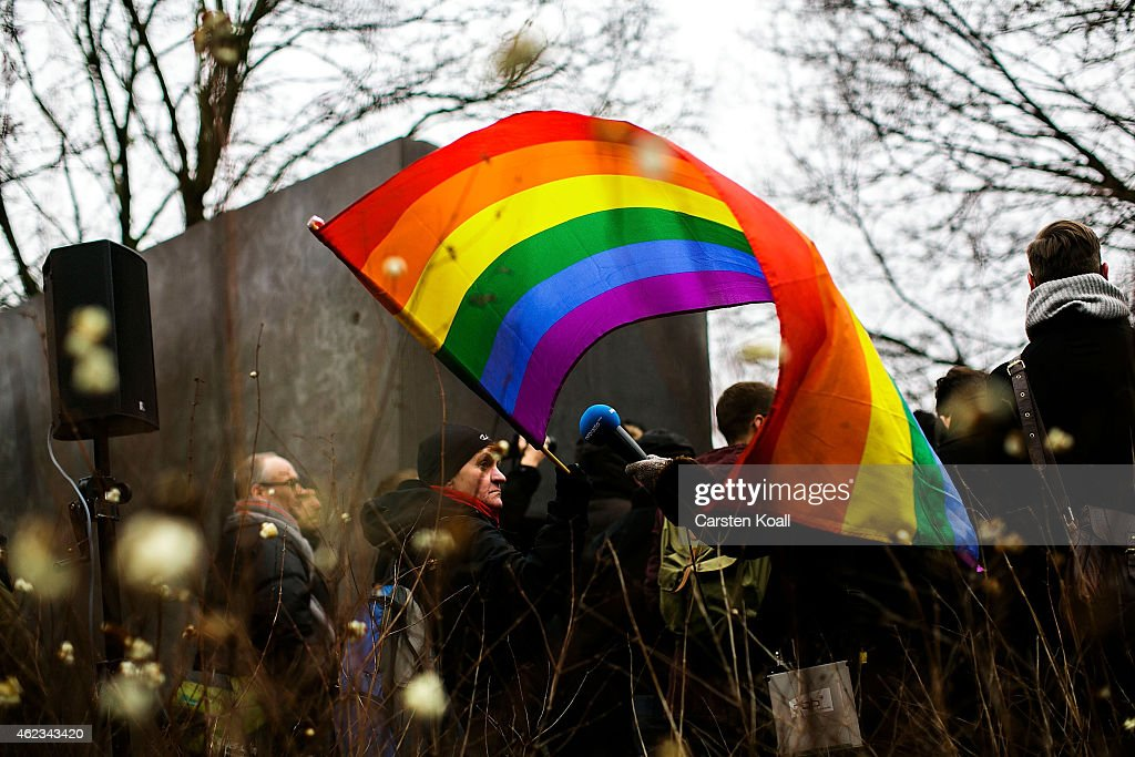 A participant of a memorial event holds a rainbow flag at a ceremony at the memorial to the homosexuals persecuted by the Nazis on January 27 2015 in...