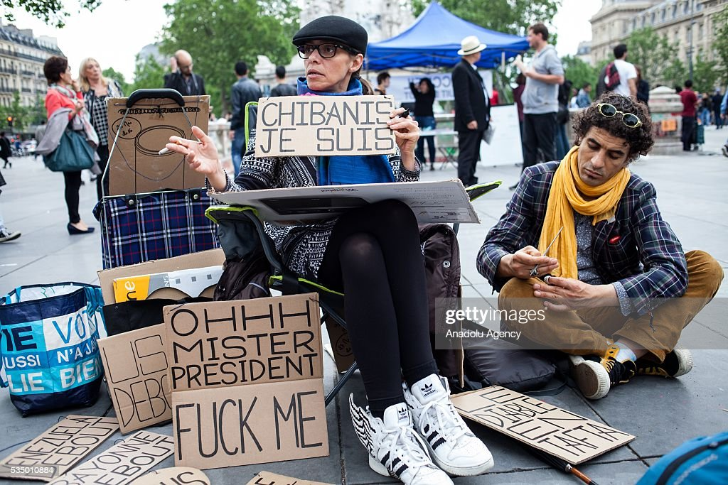 A participant of Nuit debout with severals banners at Nuit debout global meeting in Paris, France on May 28, 2016.