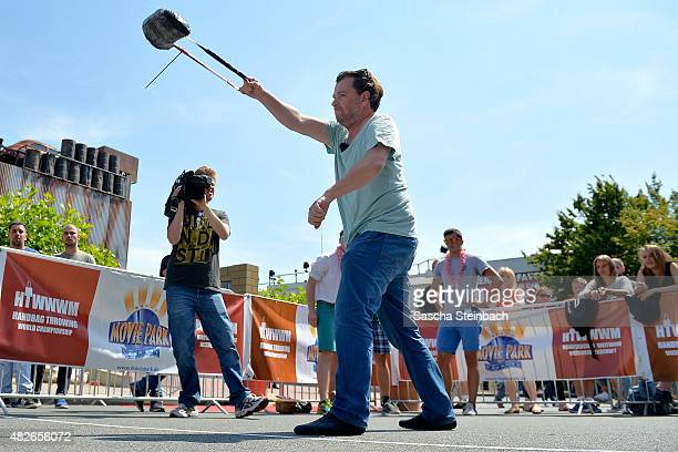 A participant of team Austria launches a handbag in the 4th annual World Handbag Throwing Championships at Movie Park Germany on August 1 2015 in...