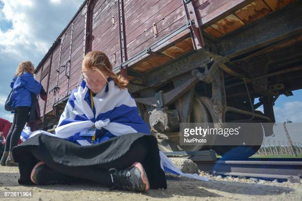 A participant of the annual March of the Living meditates near the wagonmemorial inside the former German Nazi Death Camp AuschwitzBirkenau Jewish...