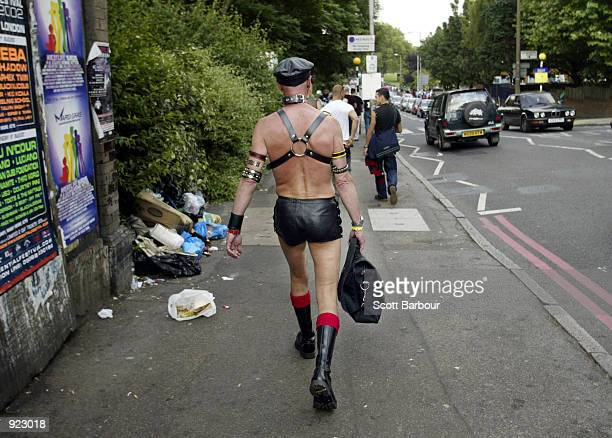 A participant of the Mardi Gras makes his way through the streets of London to a party to celebrate the Mardi Gras on July 6 2002 at Hackney Marshes...