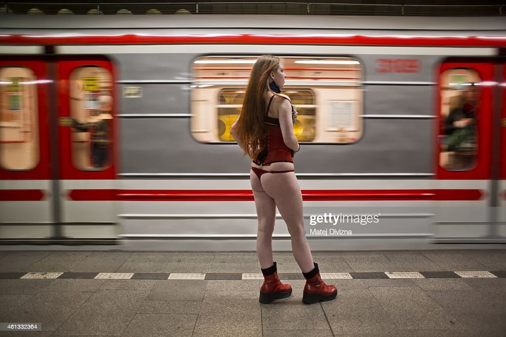 A participant of the No Pants Subway Ride waits for a train on January 11 2015 in Prague Czech Republic The annual event in which participants board...