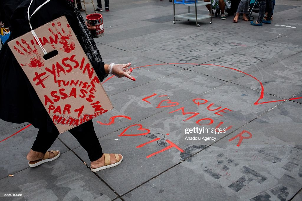 A participant of the 'Nuit Debout' make a grafiti 'Que l'amour soit' ( That love is ) on the Place de la Republique during the Global Debout meeting as the 'Nuit Debout' in Paris, France on May 28, 2016.