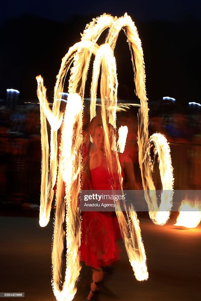 A participant performs a fire show during a festival of street culture ''Action Friends'' at the Park Kuzminki, in Moscow, Russia, on May 30, 2016.
