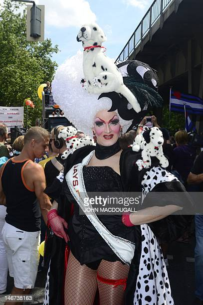A participant poses for a photo before Berlin's annual Christopher Street Day parade on June 23 2012 Gays and lesbians all around the world are...