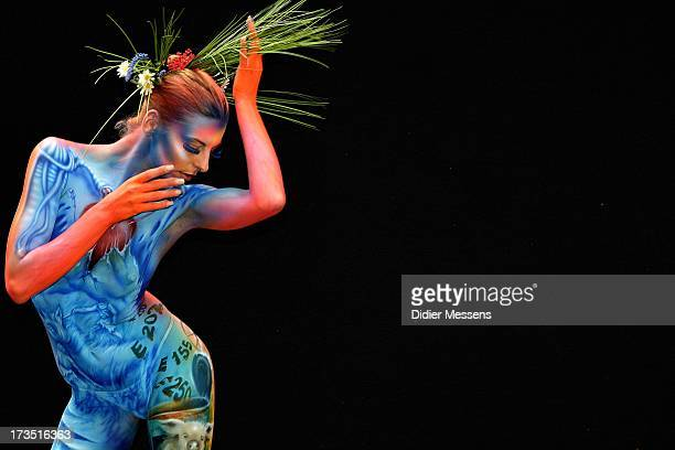 A participant poses with her body paintings designed by bodypainting artist Melanie Hill during the 16th World Bodypainting Festival in Poertschach...