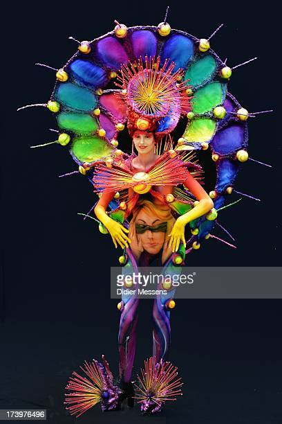 A participant poses with her body paintings designed by bodypainting artist Tsemko Tantiana during the 16th World Bodypainting Festival in...