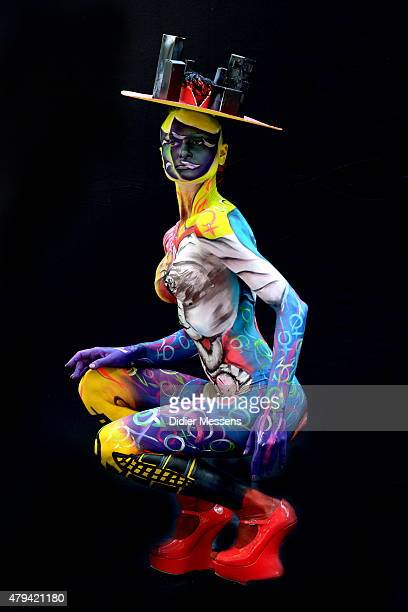 A participant poses with her body paintings designed by bodypainting artist Larissa Tulchinski from Israel in the 2015 World Bodypainting Festival on...