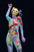 A participant poses with her body paintings designed by bodypainting artist Fernando Machado from Uruguay in the 2015 World Bodypainting Festival on...