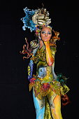 A participant poses with her bodypainting designed by bodypainting artist Decarli Ludwig from Austria in the 2015 World Bodypainting Festival on July...