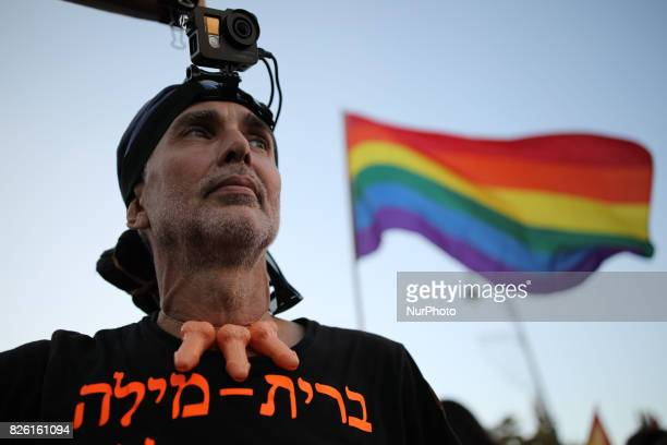 A participant protests against the practice of circumcision during the annual Gay Pride parade in Jerusalem Israel August 03 2017 22000 March in...