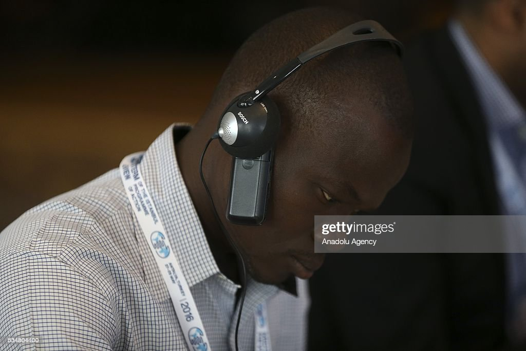 A participant puts a tape recorder between the simultaneous earphones and his ear during 'Trade and commodities and economic diversification and graduation' meeting within the Midterm Review of the Istanbul Programme of Action at Titanic Hotel in Antalya, Turkey on May 28, 2016. The Midterm Review conference for the Istanbul Programme of Action for the Least Developed Countries takes place in Antalya, Turkey from 27-29 May 2016.