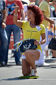A participant reacts after launching a handbag in the 4th annual World Handbag Throwing Championships at Movie Park Germany on August 1 2015 in...