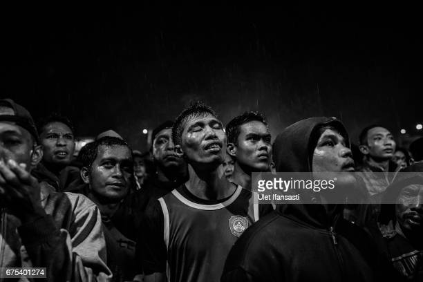 A participant reacts to watching his friend during Pencak Dor competition at the yard of Lirboyo islamic boarding school on April 29 2017 in Kediri...