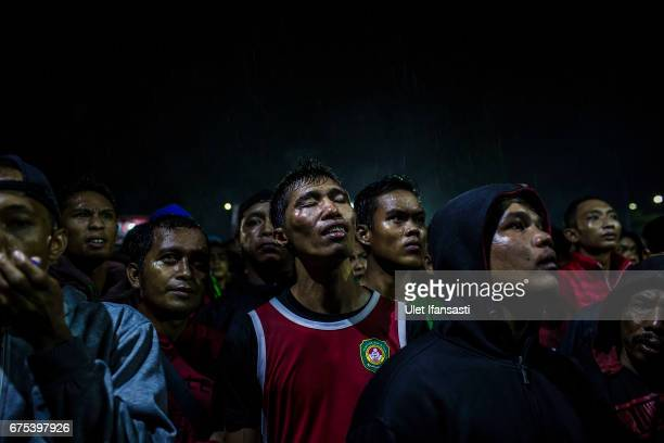 A participant reacts to watching his friend during the Pencak Dor competition at the yard of Lirboyo islamic boarding school on April 29 2017 in...