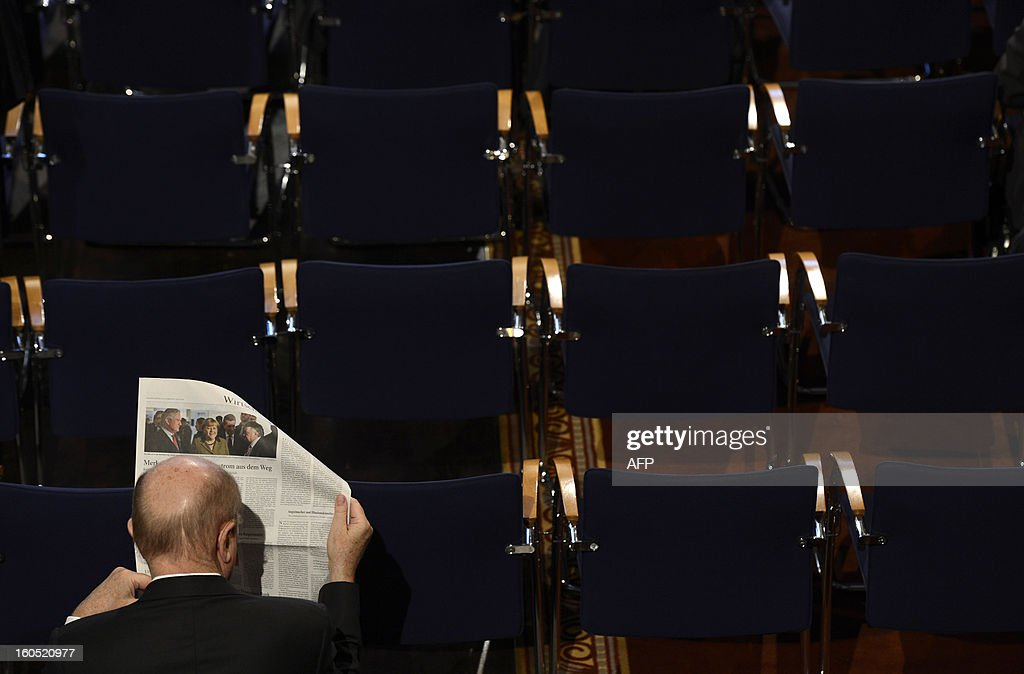 A participant reads a newspaper ahead the start of the second day of the 49th Munich Security Conference on February 2, 2013 in Munich, southern Germany as world leaders, ministers and top military gather for talks with the spotlight on Syria, Mali and Iran. AFP PHOTO/CHRISTOF STACHE