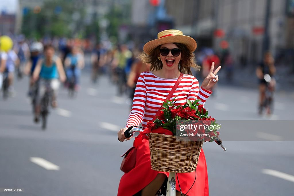 A participant ride her bicycle at the 6th Annual Moscow Bike Parade on Prospekt Akademika Sakharova, in Moscow, Russia, on May 29, 2016. The yearly event is organized by the Let's Bike It project, in Russia that bring together more than 30,000 people from across the country 16 kilometers route has been completed.