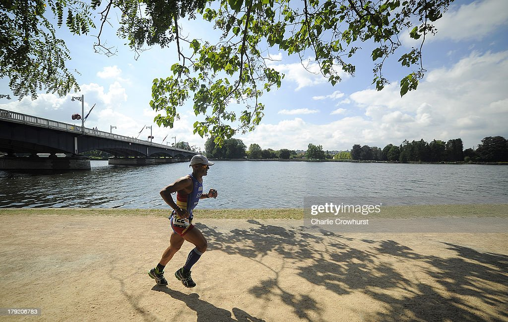 A participant runs along the river bank during the Challenge Triathlon Vichy on September 01, 2013 in Vichy, France.
