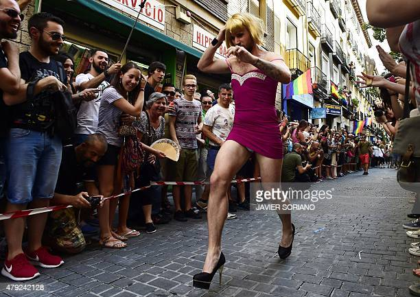 A participant runs during the 'High Heels Race' in Madrid on July 2 2015 The annual high heel race in Madrid gathers a crowd to witness participants...