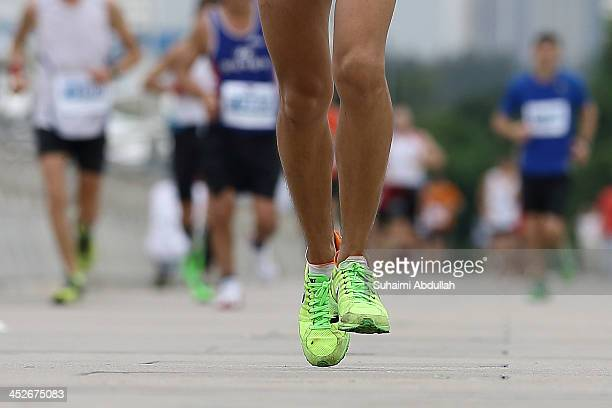 A participant runs the Singapore Standard Chartered Marathon on December 1 2013 in Singapore