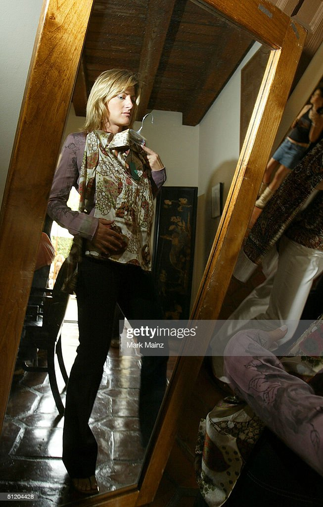A participant samples the fasions at the 'Nina Morris Trunk Show' at Patric Reeves' home August 21, 2004 in Los Feliz, California.