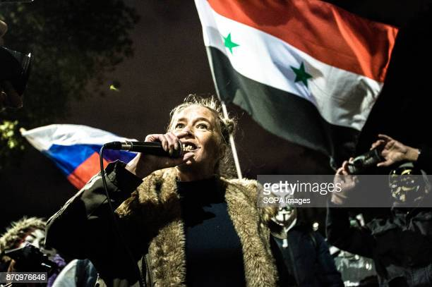 A participant seen making a speech in front of a Syrian flag during the event Demonstrators attend the Annual Million Mask March bonfire night...