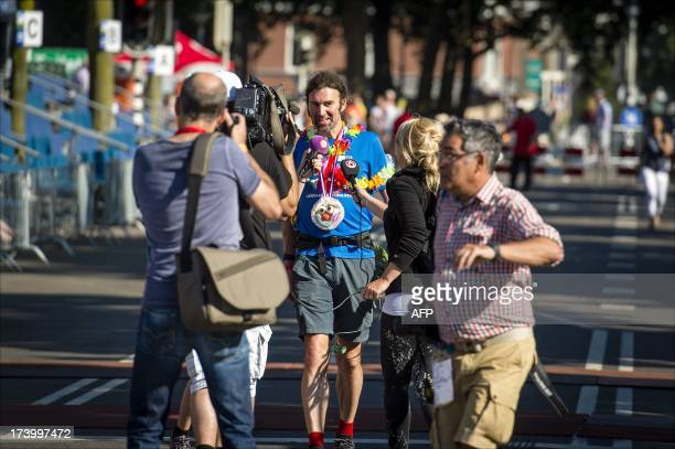 Participant Simon Brownlee from the UK talks to the press as he finishes first ranked on July 19 2013 during the fourth and final day of the...