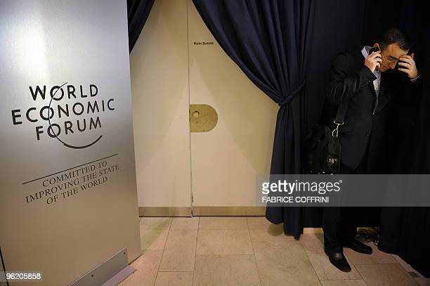 A participant speaks on his mobile phone on January 30 2009 at the World Economic Forum in Davos The head of banking giant HSBC says the sector's...