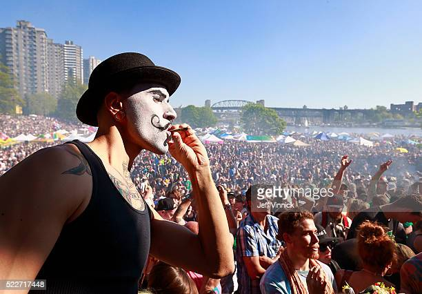 A 4/20 participant sports a painted face as he smokes marijuana at 420pm as thousands of people gathered four 4/20 celebrations on April 20 2016 at...