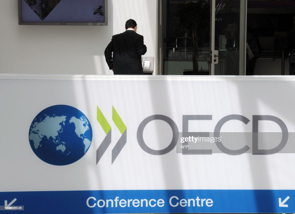 A participant stands at the OECD headquarters during the 2013 OECD Week in Paris on May 29 2013 Global economy advancing but pace of recovery varies...