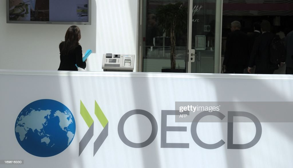 A participant stands at the OECD headquarters in Paris during the presentation of the Economic Outlook at the 2013 OECD Week on May 29 2013 AFP PHOTO...