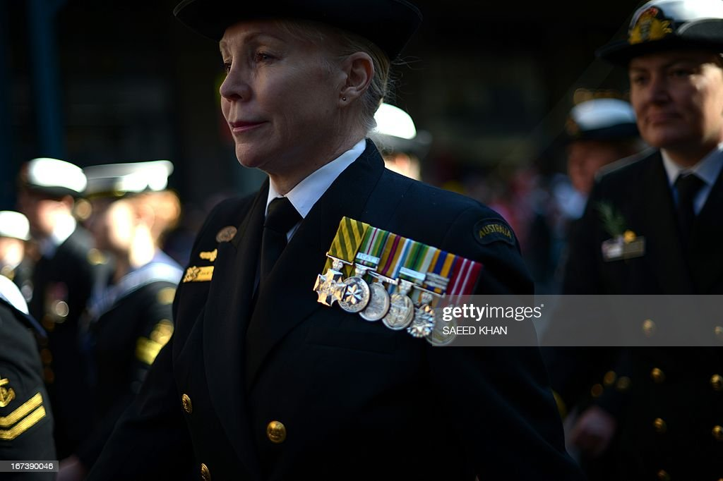 A participant takes part in the Anzac Day march in Sydney on April 25, 2013. Tens of thousands of Australians and New Zealanders turned out on April 25 to honour their war dead, with moving tributes to fallen mates and calls not to forget those injured in conflict. AFP PHOTO / Saeed Khan