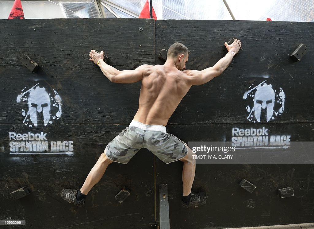 A participant tries an obstacle course on January 17, 2013, during a demonstration for the 'Spartan Race' scheduled for April 2013. The 'Spartan Race Times Square Challenge' demonstration and news conference was held at Times Square in New York to launch the multi-year business partnership between Reebok and Spartan Race.