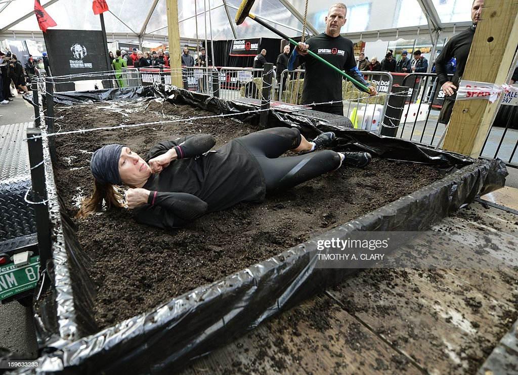 A participant tries an obstacle course on January 17, 2013, during a demonstration for the 'Spartan Race' scheduled for April 2013. The 'Spartan Race Times Square Challenge' demonstration and news conference was held at Times Square in New York to launch the multi-year business partnership between Reebok and Spartan Race. AFP PHOTO / TIMOTHY A. CLARY