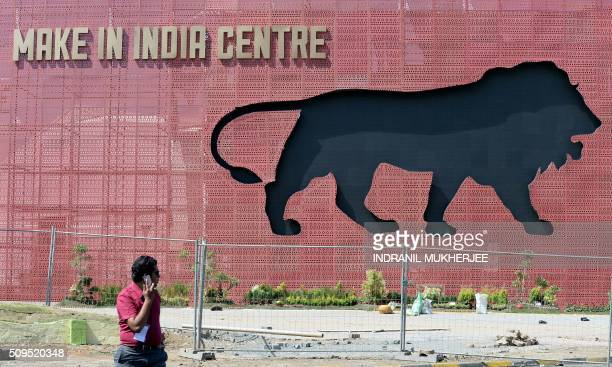 A participant walks through the venue for the 'Make in India' showcase week in Mumbai on February 11 2016 Over 190 companies including national...