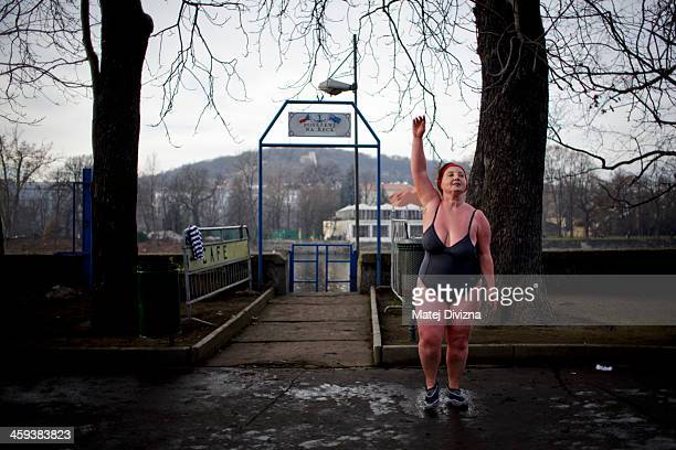 A participant warms up after the traditional Christmas winter swimming competition named in memory of Alfred Nikodem in the Vltava river on December...