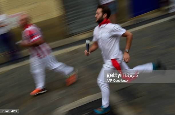 A participant warms up as he waits for the Miura's fighting bulls before the eighth and last bull run of the San Fermin festival in Pamplona northern...
