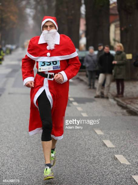 A participant warms up to compete in the 5th annual Michendorf Santa Run on December 8 2013 in Michendorf Germany Over 900 people took part in this...