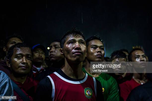 A participant watching his friends match during Pencak Dor competition at the yard of Lirboyo islamic boarding school on April 29 2017 in Kediri East...