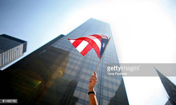 A participant waves a flag in the annual Puerto Rico Day Parade June 8 2008 in New York City The parade honoring Puerto Ricans is an annual New York...