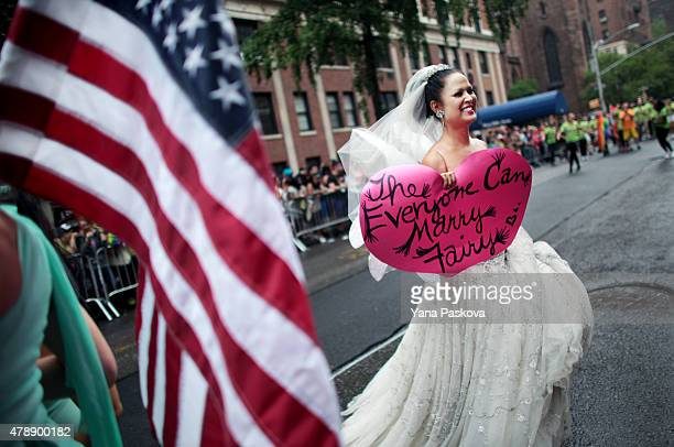 A participant wearing a wedding dress marches in the Gay Pride Parade on June 28 2015 in New York City The parade is being held two days after the US...