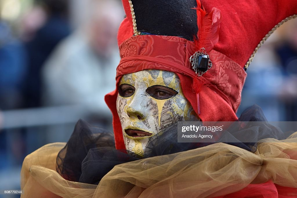 A participant wearing costume is seen at the Piazza Navona, one of the tourist area of the city, during a carnival, which is held every year on February, in Rome, Italy on February 6, 2016.