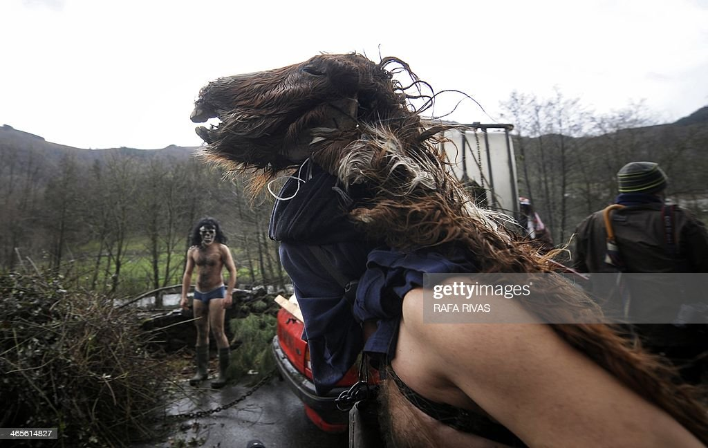 A participant wears a dead horses head during the ancient carnival of Zubieta, in the northern Spanish province of Navarra province, on January 28, 2014. The yearly three day festivities, revolving mainly around agriculture and principally sheep hearding, run on the last Sunday, Monday and Tuesday of January where Navarra Valley locals from three villages dress up and participate in a variety of activites as they perform a pilgrimage through each village.
