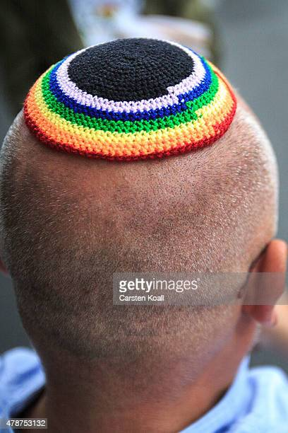 A participant wears a kippa with the rainbow colors as he attends a Christopher Street Day parade on June 27 2015 in Berlin Germany Similar marches...