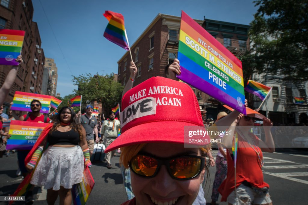 A participant wears a modified Donald Trump campaign hat during the 46th annual Gay Pride march June 26, 2016 in New York. New York kicked off June 26 what organizers hope will be the city's largest ever Gay Pride march, honoring the 49 people killed in the Orlando nightclub massacre and celebrate tolerance. / AFP / the 46th / Bryan R. Smith