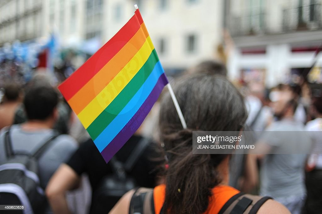 A participant wears a Rainbow flag while taking part in the Gay Pride homosexual bisexual and transgender visibility march on June 14 in Nantes...