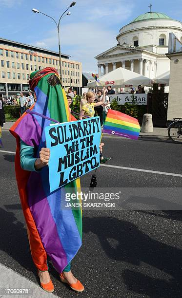 A participant wears a rainbowcolored burka as she solidarizes with muslim lesbian gay bisexual transgender and queer people during a gay pride parade...